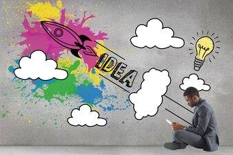 Businessman sitting with creative illustration