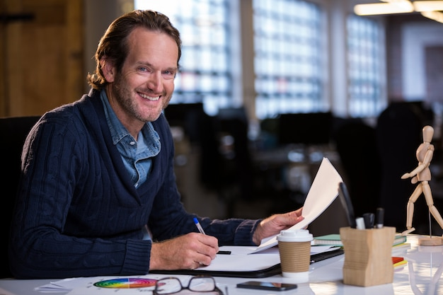 Businessman smiling while working at desk