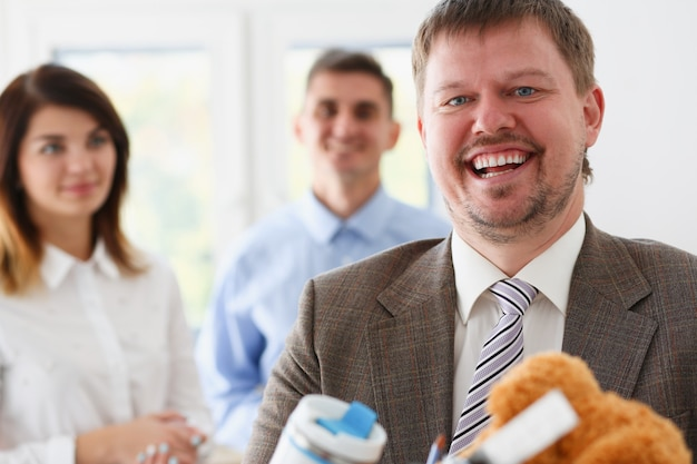 Businessman smiling with blurred colleagues