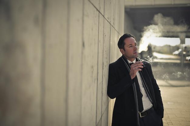 Businessman smoking outdoor