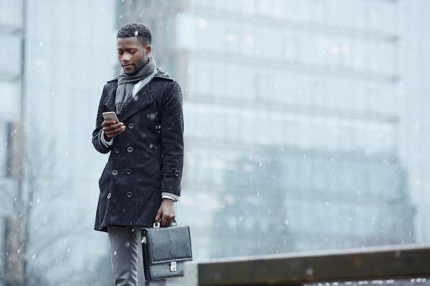 Businessman in snowfall
