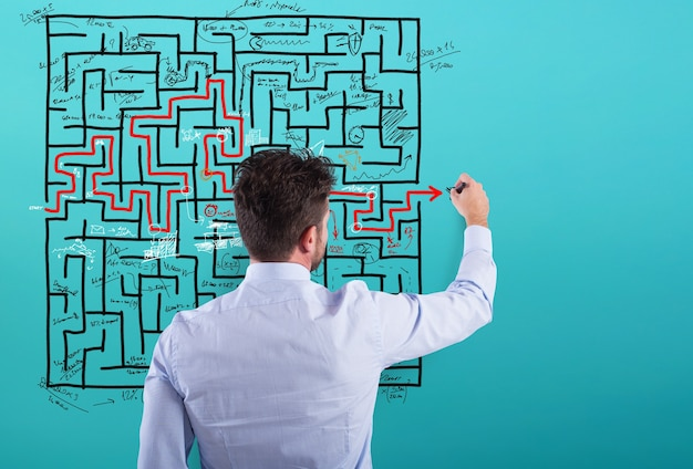 Businessman solve a complex maze with a lot of difficulties