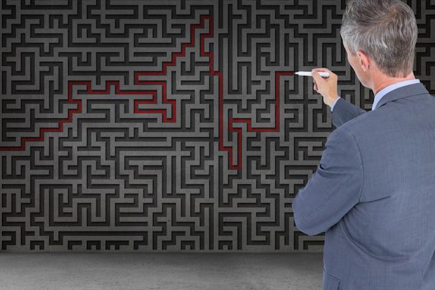 Businessman solving a maze