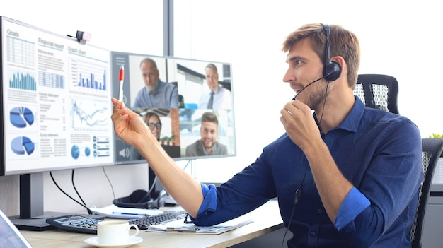 Businessman speak talk on video call with colleagues on online briefing during self isolation