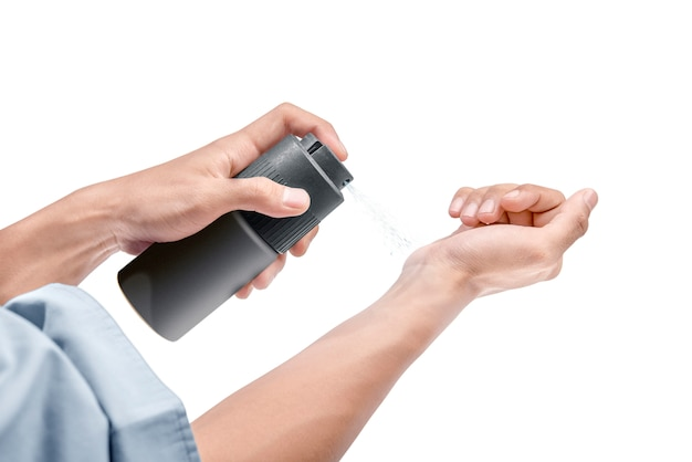 Businessman spraying perfume on his hands