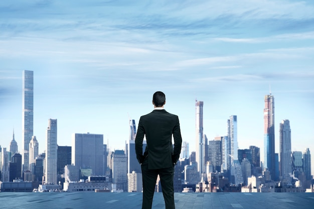 Businessman stand at rooftop of building