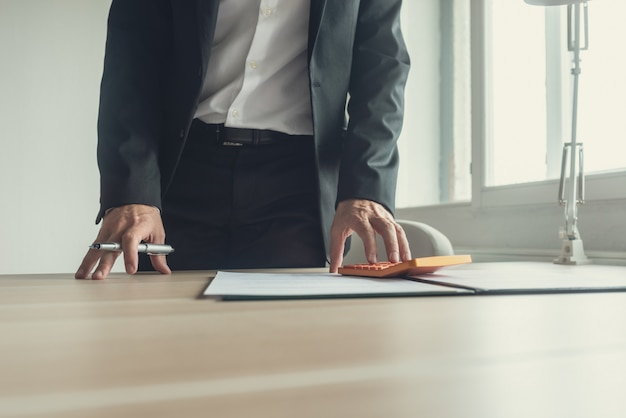 Businessman standing at his desk