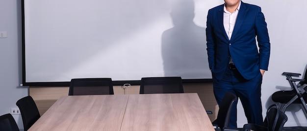 Businessman standing in seminar room