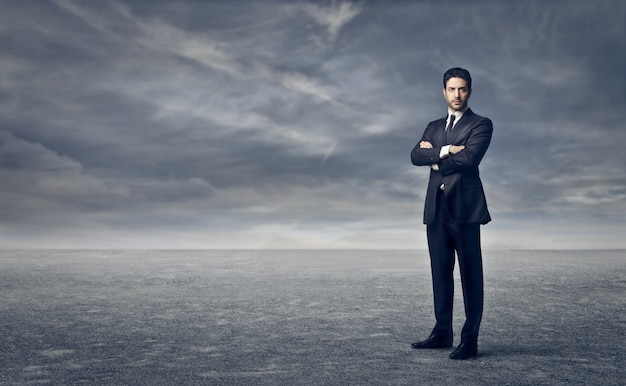 Businessman standing in a storm
