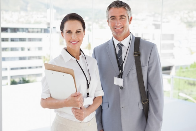 Businessman standing with co worker before a meeting