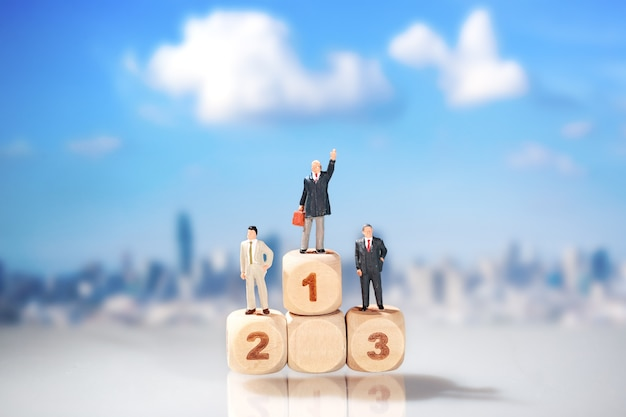 Businessman standing on wooden podium with city blur background