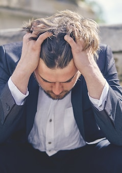 A businessman stressed from work