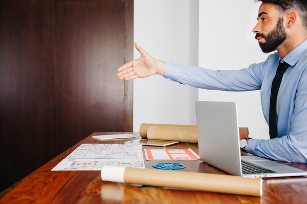 Businessman stretching out hand
