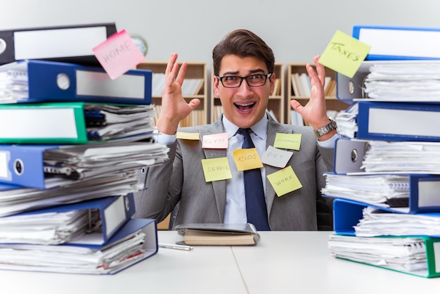Businessman struggling with multiple priorities