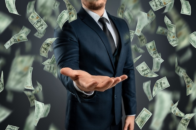 A businessman in a suit catches the falling dollars. the concept of investments, dividends, interest, bank deposits.