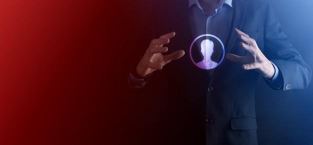 Businessman in suit holding out hand icon of user