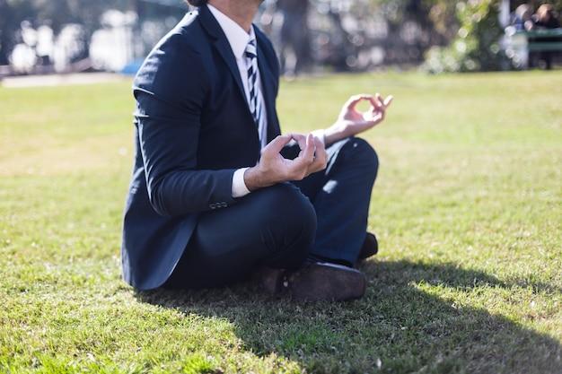 Businessman in suit practicing yoga