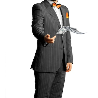 Businessman in a suit throws money isolated on white background. business concept