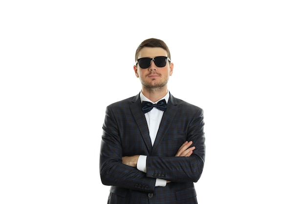 Businessman in sunglasses, isolated on white background.