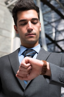 Businessman taking a look at his watch
