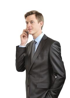 携帯電話で話しているビジネスマン。孤立