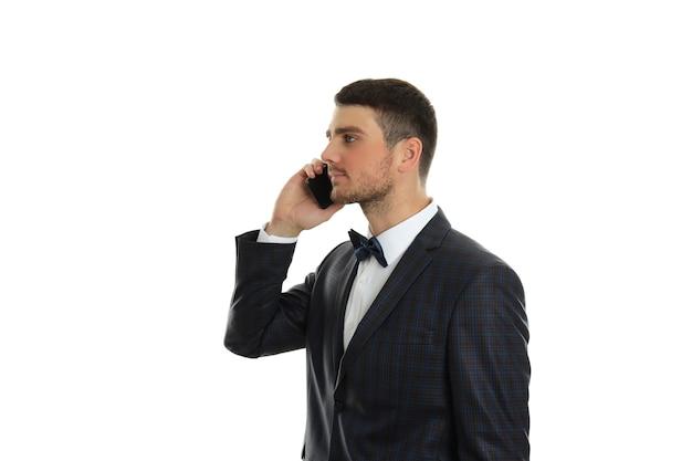 Businessman talking on phone, isolated on white background.