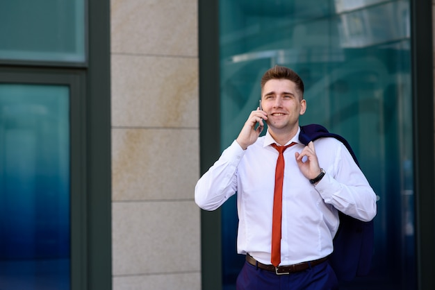 Businessman talking on the phone and smiling.