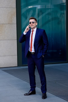 Businessman talking on the phone with a client.