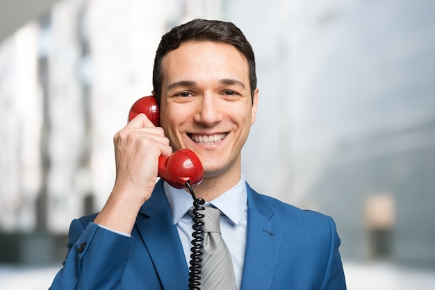 Businessman talking on a vintage telephone