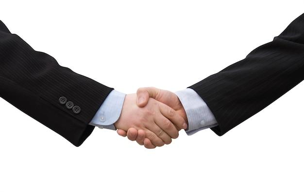 Партнеры по совместной работе бизнесмен, пожимая руки