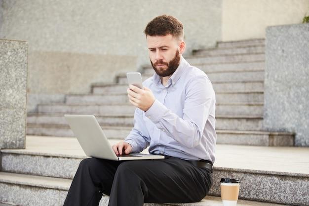 Businessman texting colleague