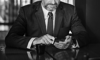 Businessman texting on his mobile phone