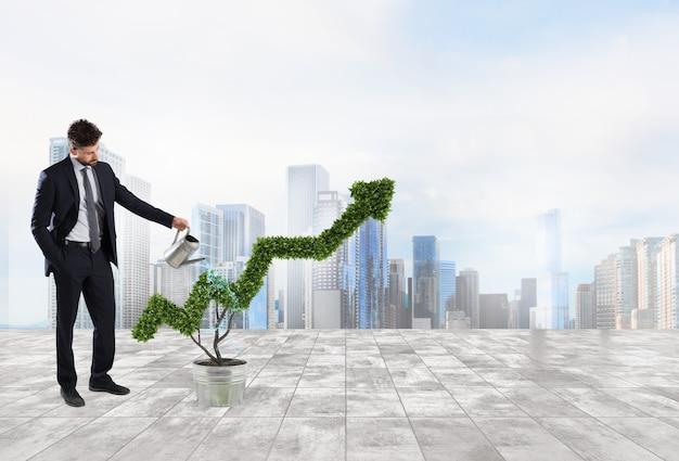 矢印の形で植物に水をやるビジネスマン