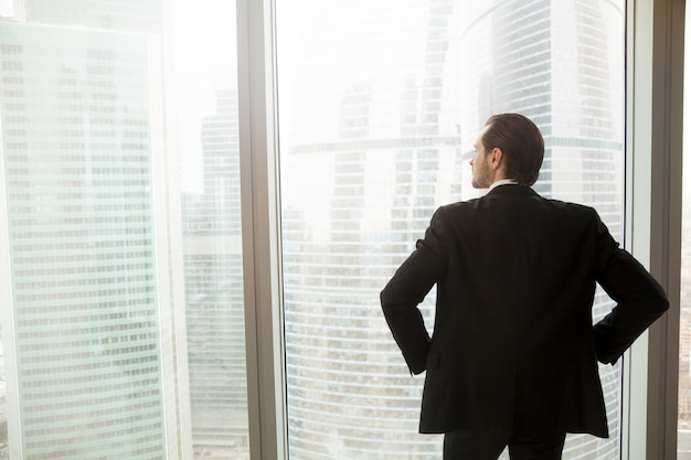 Businessman thinking about future near window