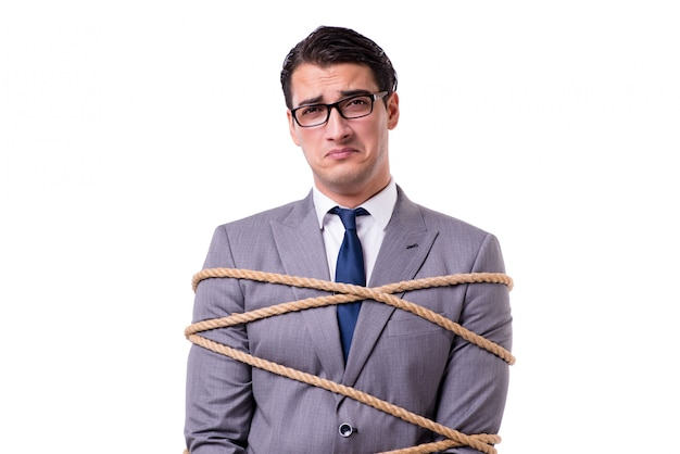 Businessman tied up with rope isolated