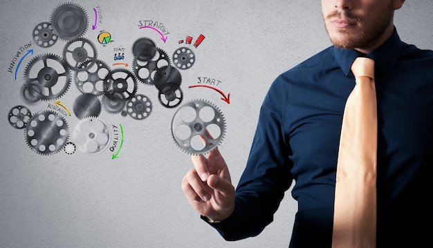 設計されたギアメカニズムで分析プロジェクトに触れるビジネスマン