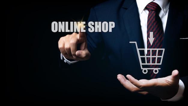Businessman touching online shop button. e-commerce business online concept. shopping online concept.