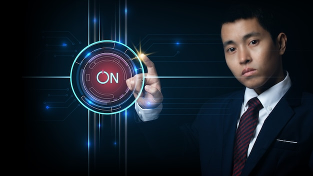 Businessman touching screen, pushing on a touch screen power button. concept innovation.