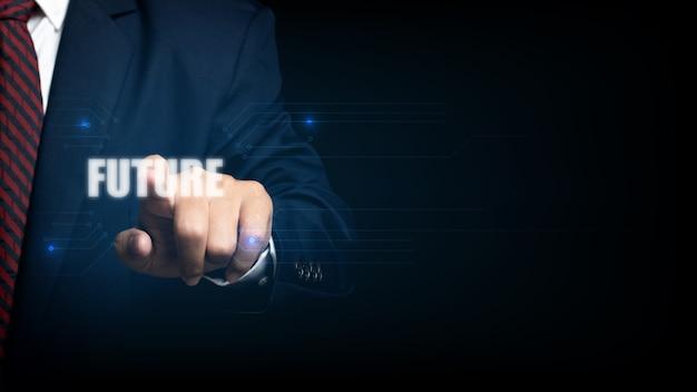 未来という言葉で仮想画面に触れるビジネスマン。将来のイノベーションコンセプト。
