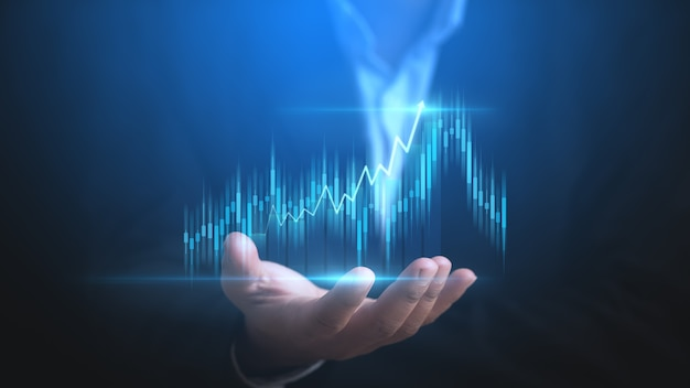 Businessman or trader is showing a growing virtual hologram stock invest in trading