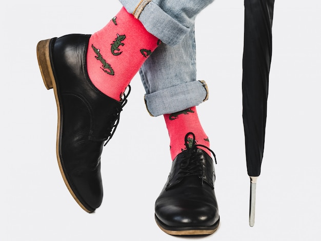 Businessman, trendy shoes, jeans and bright socks