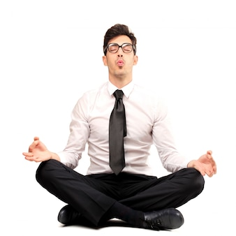 Businessman trying to meditate