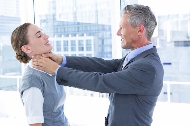 Businessman trying to smother his colleague