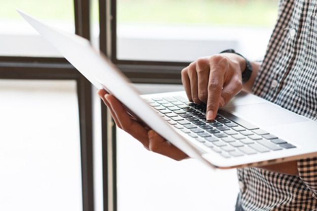 Businessman type on laptop for working