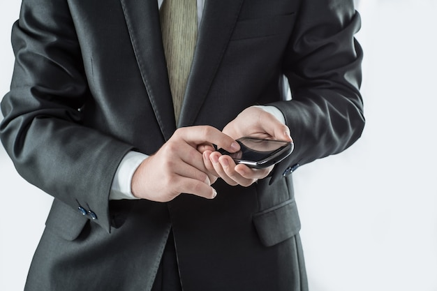Businessman typing sms on smartphone