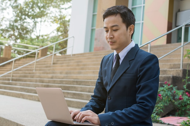Businessman use computer outdoor