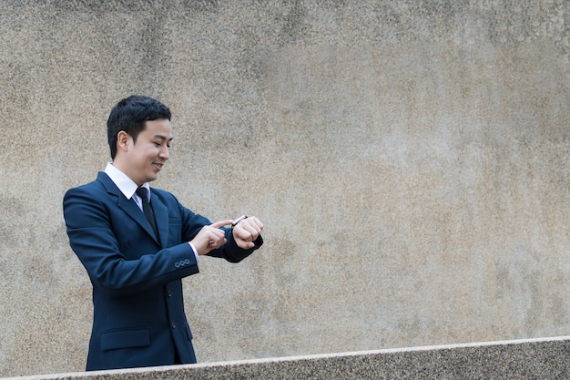 Businessman uses smartwatch