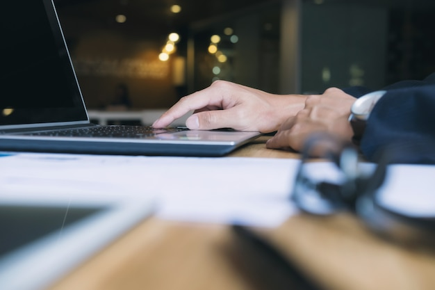 Businessman using computer to analyse data.