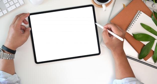 Businessman using digital tablet blank screen display on workspace