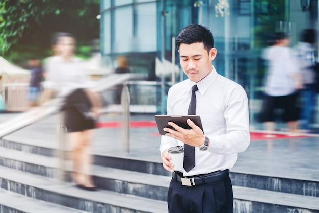 Businessman using a digital tablet office outdoors